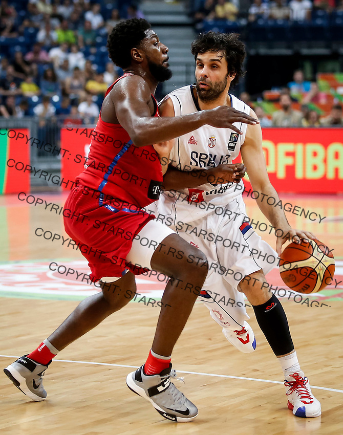 BELGRADE, SERBIA - JULY 04: Milos Teodosic (R) of Serbia in action against John Holland (L) of Puerto Rico during the 2016 FIBA World Olympic Qualifying basketball Group A match between Serbia and Puerto Rico at Kombank Arena on July 04, 2016 in Belgrade, Serbia. (Photo by Srdjan Stevanovic/Getty Images)
