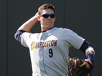 Catcher Peter O'Brien (9) of the Charleston RiverDogs prior to a game against the Greenville Drive on Saturday, April 6, 2013, at Fluor Field at the West End in Greenville, South Carolina. Charleston won Game 1 of a doubleheader, 6-2. (Tom Priddy/Four Seam Images)