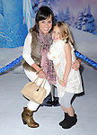 Hollywood, CA - NOVEMBER 19: Constance Zimmer and Colette Zoe Lamoureux arrives at The Disney FROZEN Premiere held at The El Capitan Theatre in Hollywood, California on November 19,2012                                                                               © 2013 Hollywood Press Agency