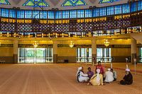 Men Talking in the Prayer Hall of the Masjid Negara (National Mosque), Kuala Lumpur, Malaysia.