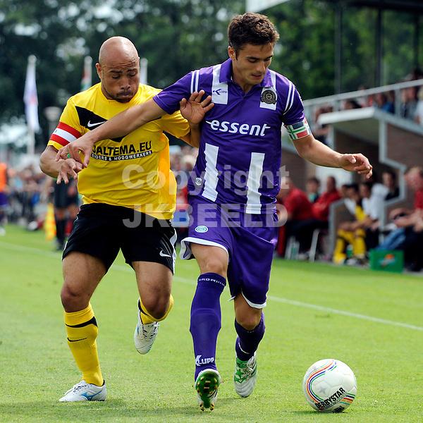 MUSSEL - SC Veendam - FC Groningen voorbereiding seizoen 2011-2012 , 16-07-2011 Veendam speler Angelo Cijntje (l) in duel met Groningen speler Dusan Tadic (r).