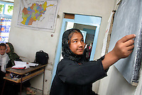 A young girl attends school. Under the Taliban, it was forbidden for women to be educated. Kabul,Afghanistan,Asia.