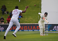 Shannon Gabriel fields Henry Nicholls' shot off his own bowling during day one of the International Test Cricket match between the New Zealand Black Caps and West Indies at the Basin Reserve in Wellington, New Zealand on Friday, 11 December 2020. Photo: Dave Lintott / lintottphoto.co.nz