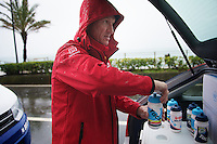 Milan - San Remo 2013: the iced edition.<br /> <br /> soigneur Marc Van Gyseghem getting the bidons ready for the 2nd part of the race