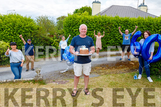 Kevin Williams receives a surprise 60th birthday cake and trimmings from  his friends from the Tralee Swimming Club at his home on Tuesday. <br /> L to r: Elaine Burrows Dillane, John O'Sullivan, Rosemarie Collins, Morna O'Halloran, Ger McDonnell and his daughter Danielle McGrath.