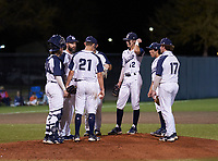 Calvary Christian Warriors mound meeting with catcher Eli Kapkowski (34), pitcher Tyler Dietz (21), third baseman Miles Curley (28), shortstop Landen Maroudis (12), second baseman Matt Rose (1), and first baseman Jackson Unice (17) during a game against the Lakeland Christian Vikings on February 27, 2021 at Calvary Christian High School in Clearwater, Florida.  (Mike Janes/Four Seam Images)