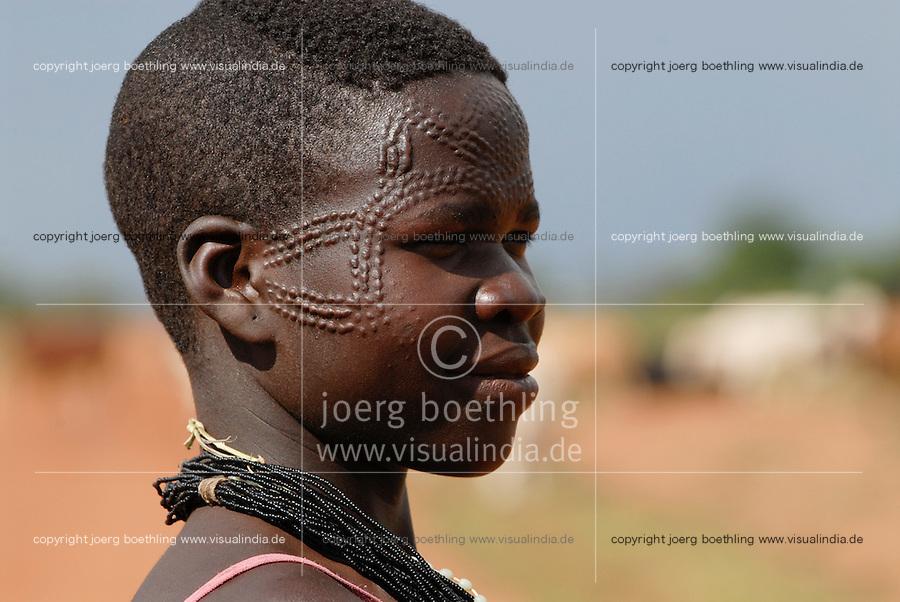 UGANDA Karamoja , Karimojong a pastoral tribe , young woman with facial ornament / UGANDA Karamoja , Volk der Karimojong , junge Frau mit Gesichtsverzierung und Schmuck
