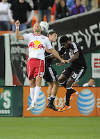 New York Red Bulls midfielder Joel Lindpere (20) head the ball against DC United defender Chris Korb (22) and midfielder Cyde Simms (19)    The New York Red Bulls defeated DC United 4-0, at RFK Stadium, Saturday April 21, 2011.