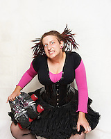 Dreadnought, of the roller derby team, the Boston Derby Dames. Roller derby is an American contact sport, popular with young women, which combines both athleticism and a satirical punk third-wave feminism aesthetic.