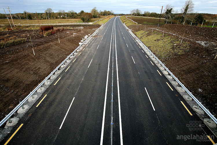Dromod-Rooskey bypass. The 7 kilometre stretch will see journey times between Carrick-On -Shannon and Longford reduced by up to 10 minutes..The project, costing 18 million, has been completed 4 months ahead of schedule. Speaking at this afternoons opening, Minister Devins says plans to extend the by pass to Newtownforbes are being considered by the National Roads Authority.