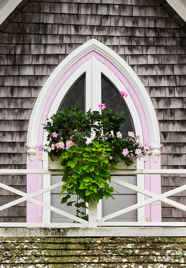 Window box and arched window deatail of a Victorian cottage, Oak Bluffs, Martha's Vineyard, Massachusetts, USA.