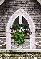 Window box and arched window deatail of a Victorian cottage, Oak Bluffs, Martha's Vineyard, Massachusetts, USA.