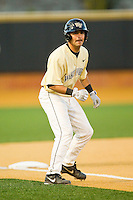 Pat Blair (11) of the Wake Forest Demon Deacons takes his lead off of third base against the North Carolina State Wolfpack at Wake Forest Baseball Park on March 15, 2013 in Winston-Salem, North Carolina.  The Wolfpack defeated the Demon Deacons 12-6.  (Brian Westerholt/Four Seam Images)
