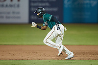 Lolo Sanchez (34) of the Greensboro Grasshoppers takes off for second base during the game against the Winston-Salem Dash at First National Bank Field on June 3, 2021 in Greensboro, North Carolina. (Brian Westerholt/Four Seam Images)