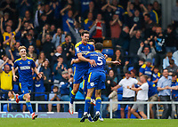 4th September 2021; Merton, London, England;  EFL Championship football, AFC Wimbledon versus Oxford City: Will Nightingale of AFC Wimbledon celebrates after scoring his sides his sides 2nd goal in the 78th minute to make it 2-1 with Ben Heneghan and Ollie Palmer of AFC Wimbledon