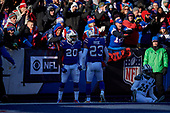 Buffalo Bills Rafael Bush (20) and Micah Hyde (23) celebrate breaking up a pass to Robby Anderson (11) during an NFL football game against the New York Jets, Sunday, December 9, 2018, in Orchard Park, N.Y.  (Mike Janes Photography)