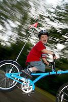 Josh on tagalong bike   ..Virginia Water , Surrey , July 2004..