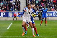 Harrison, NJ - Sunday March 04, 2018: Christen Press, Marion Torrent during a 2018 SheBelieves Cup match match between the women's national teams of the United States (USA) and France (FRA) at Red Bull Arena.