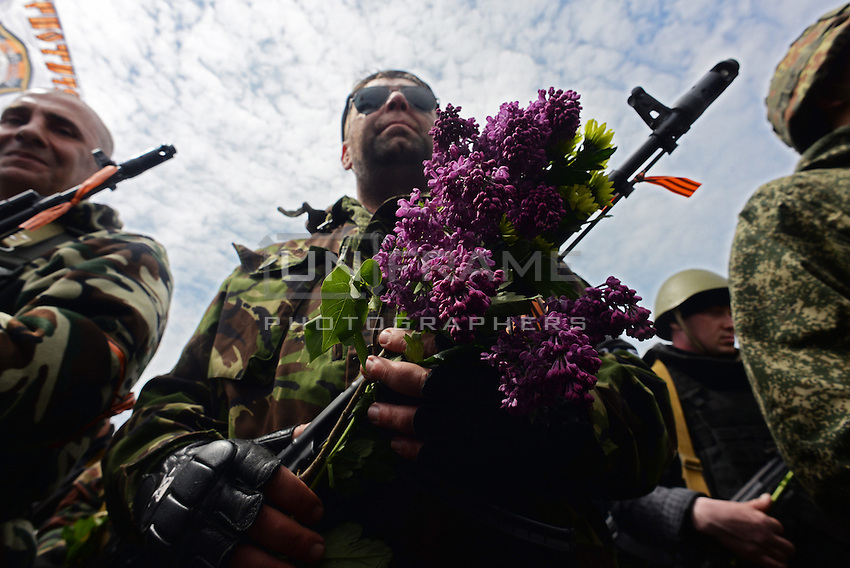 Boquet of flowers and guns seen during the celebration of the Victory Day, the Soviet holiday commemorating the defeat of the Nazis.  Sunday is May 11, the proposed date for the separatists' referendum on greater autonomy for eastern Ukraine.