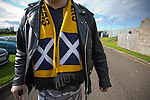 Berwick Rangers 5 East Stirlingshire 0, 23/08/2014. Shielfield Park, Scottish League Two. A home supporter with a scarf featuring a Scottish saltireflag, making his way from Shielfield Park, after the Scottish League Two fixture between Berwick Rangers and East Stirlingshire. The home club occupied a unique position in Scottish football as they are based in Berwick-upon-Tweed, which lies a few miles inside England. Berwick won the match by 5-0, watched by a crowd of 509. Photo by Colin McPherson.