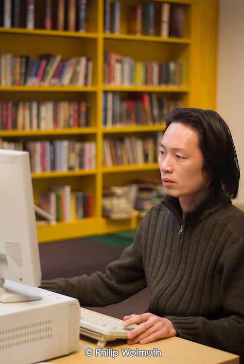 Using a computer in Westminster City Council's Charing Cross library, which offers a specialist Chinese service.