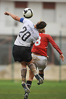 Abby Wambach wins a header vs Norway during the 2010 Algarve Cup.