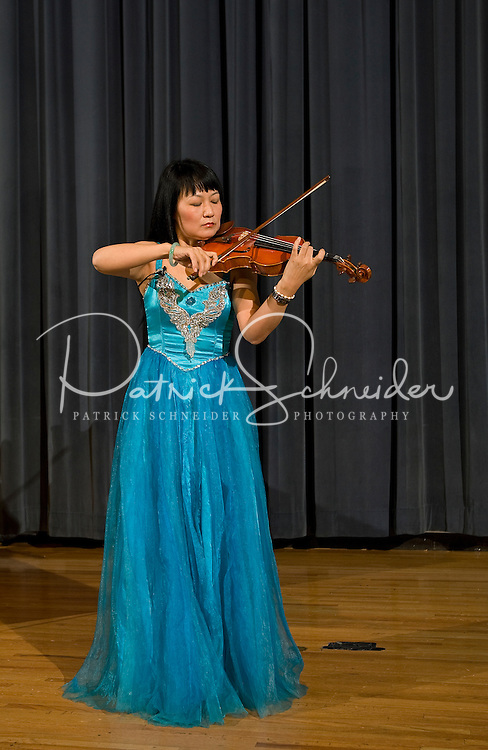 A woman plays the violin during a Chinese New Year Celebration at UNC Charlotte in Charlotte, NC.
