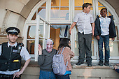 Blue 9 private security guards prevent protesters from entering Hendon Town Hall through a window.  Tenants, evicted tenants and housing campaigners in Barnet, north London, protest over the sale of West Hendon estate and the demolition of Sweets Way estate.