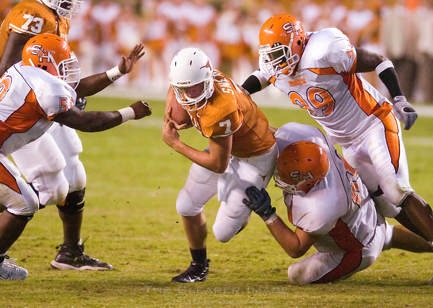 30 September 2006: Texas quarterback Jevan Snead tries to dodge a slew of defenders during the Longhorns 56-3 victory over the Sam Houston State Bearkats at Darrell K Royal Memorial Stadium in Austin, TX.