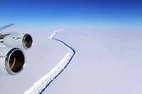 """Pictured: Aerial view of the rift in the Larsen C<br /> Re: Antarctic ice rift close to calving, after growing 17km in 6 days – latest data from ice shelf<br /> The rift in the Larsen C ice shelf in Antarctica has grown by 17km in the last few days and is now only 13km from the ice front, indicating that calving of an iceberg is probably very close, Swansea University researchers revealed after studying the latest satellite data.<br /> The rift in Larsen C is likely to lead to one of the largest icebergs ever recorded.  It is being monitored by researchers from the UK's Project Midas, led by Swansea University.<br /> Professor Adrian Luckman of Swansea University College of Science, head of Project Midas, described the latest findings:<br /> """"In the largest jump since January, the rift in the Larsen C Ice Shelf has grown an additional 17 km (11 miles) between May 25 and May 31 2017. This has moved the rift tip to within 13 km (8 miles) of breaking all the way through to the ice front, producing one of the largest ever recorded icebergs.<br /> The rift tip appears also to have turned significantly towards the ice front, indicating that the time of calving is probably very close.<br /> The rift has now fully breached the zone of soft 'suture' ice originating at the Cole Peninsula and there appears to be very little to prevent the iceberg from breaking away completely."""""""