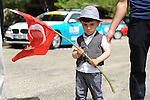 Young boy waves the Turkish Flag as the race passes by during Stage 3 of the 2015 Presidential Tour of Turkey running 165.3km from Kemer to Elmali. 28th April 2015.<br /> Photo: Tour of Turkey/Mario Stiehl/www.newsfile.ie