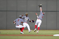 Second baseman Chandler Avant (5) of the Columbia Fireflies, playing as the Chicharrones de Columbia, catches a pop fly over his shoulder, with Shervyen Newton (3) and Gerson Molina (12) backing up the play, in a game against the Charleston RiverDogs on Friday, July 12, 2019 at Segra Park in Columbia, South Carolina. The RiverDogs won, 4-3, in 10 innings. (Tom Priddy/Four Seam Images)