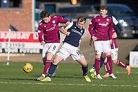 13th March 2021; Dens Park, Dundee, Scotland; Scottish Championship Football, Dundee FC versus Arbroath; Michael McKenna of Arbroath is tackled by Paul McGowan of Dundee
