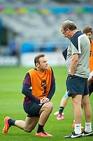 England manager Roy Hodgson talks to Wayne Rooney during training