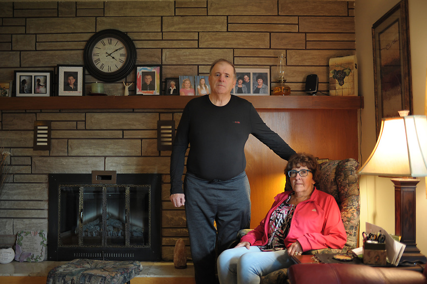 Allan and Dianne Bunz pose for a photo in their Wawota, Sask., home. Their son, Michael, was killed by H2S gas on May 22, 2014. MARK TAYLOR FOR THE TORONTO STAR