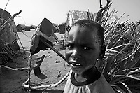 Kalma IDP camp, South Darfur, August 3, 2004.Men in the camp. This huge camp just outside Nyala shelters more than 50 000 IDP's.