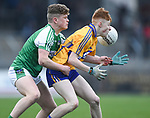 Shane Meehan of  Clare  in action against Michael O Hanrahan of  Limerick during their Munster Minor football quarter final at  Cusack Park. Photograph by John Kelly.
