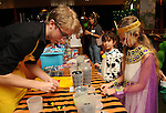 Bethany Rodriguez plays at the Lego table at the M.D. Anderson Halloween party at The Galleria Sunday Oct 25, 2015.(Dave Rossman photo)