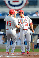 Palm Beach Cardinals first baseman Jonathan Rodriguez #28 greets Stephen Piscotty #16 after hitting a home run during a game against the Charlotte Stone Crabs at Charlotte Sports Park on April 7, 2013 in Port Charlotte, Florida.  Palm Beach defeated Charlotte 8-1.  (Mike Janes/Four Seam Images)
