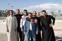 Tripoli, Libya - Young Libyan Men, near Green Square.  Two wear a traditional juba, others wear Western style clothes, including denim and levis.