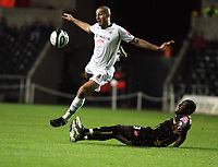 Pictured: Darren Pratley of Swansea (L) tackled by Damion Stewert of Queens Park Rangers (R).<br /> Re: Coca Cola Championship, Swansea City Football Club v Queens Park Rangers at the Liberty Stadium, Swansea, south Wales 21st October 2008.