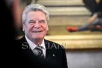 German President Joachim Gauck,Pope Benedict XVI and German President Joachim Gauck exchange gifts during a private audience on December 6, 2012 in the pontif's library at the Vatican