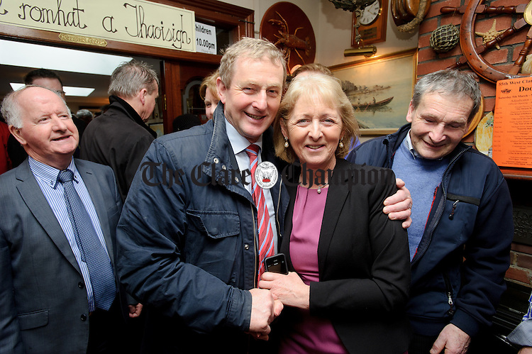 Enda Kenny, Taoiseach, with Josie from mayo during his visit to Loop Head to launch the Fine Gael tourism initiative. Photograph by John Kelly.