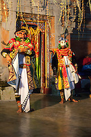 Bali, Indonesia. Two Men Performing a Traditional Story as Part of a Ceremony Praying for a Bountiful Rice Harvest.  Pura Dalem Temple, Dlod Blungbang Village.