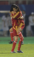 Chinese teammates Liu Sa (left) and Xie Caixia embrace following their first round game at the 2007 FIFA Women's World Cup at Wuhan Sports Center Stadium in Wuhan, China.  China defeated Denmark, 3-2.
