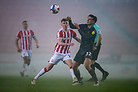 29th December 2020; Bet365 Stadium, Stoke, Staffordshire, England; English Football League Championship Football, Stoke City versus Nottingham Forest; Ryan Yates of Nottingham Forest heads the ball away from Sam Clucas of Stoke City