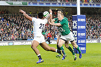 Manu Tuilagi of England fumbles a chip ahead in the in-goal area as Keith Earls of Ireland (centre) pounces to stop a try during the RBS 6 Nations match between Ireland and England at the Aviva Stadium, Dublin on Sunday 10 February 2013 (Photo by Rob Munro)