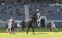 LOS ANGELES, CA - APRIL 17: Jesús David Murillo #94 of LAFC and Jhohan Romaña #3 of Austin FC battle in the air during a game between Austin FC and Los Angeles FC at Banc of California Stadium on April 17, 2021 in Los Angeles, California.