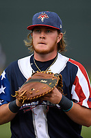 First baseman Dash Winningham (34) of the Columbia Fireflies warms up before a game against the Rome Braves on Monday, July 3, 2017, at Spirit Communications Park in Columbia, South Carolina. Columbia won, 1-0. (Tom Priddy/Four Seam Images)