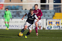 13th March 2021; Dens Park, Dundee, Scotland; Scottish Championship Football, Dundee FC versus Arbroath; Paul McGowan of Dundee races away from Scott Stewart of Arbroath